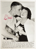 Autographs:Photos, 1961 Roger Maris Wire Photograph Celebrating Sixtieth Home Run, Signed. The widow of Babe Ruth graciously accepts a kiss fr...
