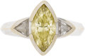 Estate Jewelry:Rings, Colored Diamond, Diamond, Gold Ring. The ring centers a marquise-cut brownish-yellow diamond measuring 12.00 x 6.00 x 3.75...