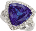 Estate Jewelry:Rings, Tanzanite, Diamond, Gold Ring. The ring is highlighted by atriangle-cut tanzanite measuring 14.50 x 14.90 x 9.50 mm and w...