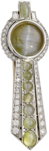 Estate Jewelry:Brooches - Pins, Art Deco Cat's-Eye Chrysoberyl, Diamond, Platinum Brooch. Thebrooch is highlighted by a cat's-eye chrysoberyl cabochon me...