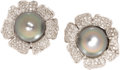 Estate Jewelry:Earrings, South Sea Cultured Pearl, Diamond, White Gold Earrings. Each flowerearring is highlighted by a black South Sea cultured p...