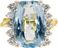 Estate Jewelry:Rings, Aquamarine, Diamond, Gold Ring. The ring centers a cushion-cutaquamarine measuring 18.10 x 12.35 x 9.00 mm and weighing a...