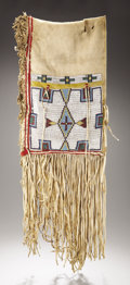 American Indian Art:Beadwork and Quillwork, A CHEYENNE BEADED BUFFALO HIDE DOUBLE SADDLE BAG. c. 1880. ...