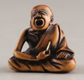 Asian:Japanese, PROPERTY FROM A DALLAS PRIVATE COLLECTION. A JAPANESE WOOD AND IVORY NETSUKE. Mid 19th Century. Signed on an inlaid ivory ...