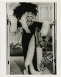 "Autographs:Celebrities, Photograph Inscribed and Signed by Mae West. Black and white 8 x10"", n.d., n.p. Great glossy full-length image of the popul..."