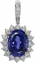 Estate Jewelry:Necklaces, Tanzanite, Diamond, White Gold Pendant-Enhancer. Thependant-enhancer centers an oval-shaped tanzanite measuring 15.65 x1...