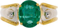 Estate Jewelry:Rings, Emerald, Twotone Gold Ring. The ring features an oval-shapedemerald measuring 10.30 x 8.00 x 4.40 mm and weighing approxi...