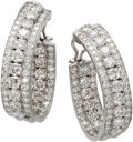 Estate Jewelry:Earrings, Diamond, Platinum Earrings. Each oversized hoop features full-cutdiamonds weighing a total of approximately 7.00 carats, ...