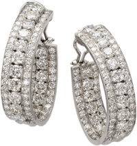 Diamond, Platinum Earrings  Each oversized hoop features full-cut diamonds weighing a total of approximately 7.00 carats...