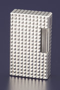 Silver Smalls:Other , A FRENCH SILVER LIGHTER. S.T. Dupont, Paris, France, circa 1950.Marks: S.T. Dupont, de PARIS, MADE IN FRANCE, Y4AP46, (...