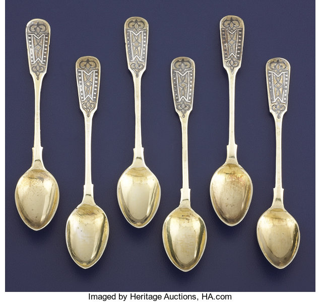 A SET OF SIX RUSSIAN SILVER GILT AND NIELLO COFFEE SPOONS