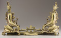 Decorative Arts, French:Other , A PAIR OF GILT METAL CHENETS AND FENDER. 20th Century. 36inches (91.4 cm) long. ... (Total: 3 Items)
