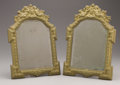 Decorative Arts, Continental:Other , TWO ITALIAN BAROQUE-STYLE BRASS REPOUSSÉ MIRRORS. Late 19thCentury. 18 x 13 inches (45.7 x 33 cm) each. ...