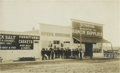 Photography:Studio Portraits, Mounted Photograph of Frontier Street with Men in Front of General Store,...