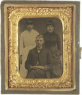 Photography:Tintypes, Lot of Two Tintype Photographs, Kid with Gun behind Him ca 1870s -... (Total: 2 Items)