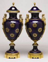 A PAIR OF SÈVRES-STYLE GILT BRONZE MOUNTED PORCELAIN VASES AND COVERS 20th Century Marks: (interlaced L<...