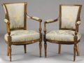 Furniture : French, TWO FRENCH DIRECTOIRE MAHOGANY AND FRUITWOODFAUTEUILS. Circa 1790-1830. 33 x 22-1/2 x 20 inches (83.8x...