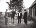 Photographs, L.A. HUFFMAN (American 1879-1931). Portfolio of three photographs of cowboys:. #152 - Conrad Kohrs (right) and Ranch Forem... (Total: 3 )