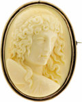 Estate Jewelry:Cameos, Victorian Ivory Cameo, Gold Pendant-Brooch. The pendant-broochfeatures an oversized ivory cameo measuring 63.00 x 48.00 x...