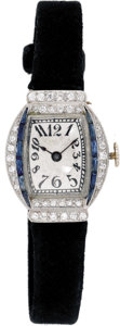 Timepieces:Wristwatch, Art Deco Swiss Lady's Diamond, Platinum, Suede Strap Wristwatch, circa 1915 . Case: 26 x 20 mm, hinged, tonneau-shaped eng...