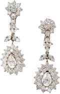 Estate Jewelry:Earrings, Diamond, Gold Earrings. Each dangling earring features apear-shaped diamond weighing approximately 0.40 carat, enhancedb...