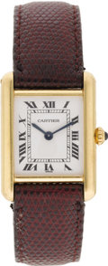 "Timepieces:Wristwatch, Cartier Lady's Gold ""Tank"" Leather Strap Wristwatch, Modern . Case:27 x 20 mm, rectangular 18k yellow gold with 4 screw c..."