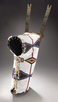 American Indian Art:Beadwork and Quillwork, A NORTHERN CHEYENNE BEADED HIDE BABY CARRIER. c. 1880. ...