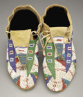 American Indian Art:Beadwork and Quillwork, A PAIR OF SIOUX BEADED HIDE MOCCASINS. c. 1880... (Total: 2 Items)
