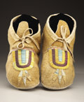 American Indian Art:Beadwork and Quillwork, A PAIR OF HIDATSA QUILLED HIDE MOCCASINS. c. 1920... (Total: 2Items)