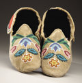 American Indian Art:Beadwork and Quillwork, A PAIR OF NORTHERN PLAINS BEADED HIDE MOCCASINS. c. 1890... (Total:2 Item)