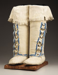 American Indian Art:Beadwork and Quillwork, A PAIR OF SOUTHERN PLAINS WOMAN'S BEADED HIDE BOOT MOCCASINS. c. 1910... (Total: 2 Items)