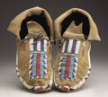 American Indian Art:Beadwork and Quillwork, A PAIR OF CHEYENNE BEADED BUFFALO HIDE MOCCASINS. c. 1870...(Total: 2 Items)