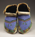 American Indian Art:Beadwork and Quillwork, A PAIR OF SIOUX BEADED BUFFALO HIDE MOCCASINS. c. 1880... (Total: 2Items)