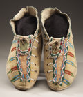 American Indian Art:Beadwork and Quillwork, A PAIR OF APACHE BEADED HIDE MOCCASINS. c. 1880... (Total: 2 Items)