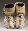American Indian Art:Beadwork and Quillwork, A PAIR OF HIDATSA BEADED HIDE MOCCASINS. c. 1885 ... (Total: 2Items)