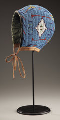 American Indian Art:Beadwork and Quillwork, A SIOUX GIRL'S BEADED HIDE BONNET. c. 1890...