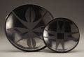 American Indian Art:Pottery, TWO SAN ILDEFONSO BLACKWARE PLATES. Maria and Santana Martinez.Maria Martinez. c. 1950 and 1925... (Total: 2 Items)
