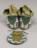 American Indian Art:Beadwork and Quillwork, A PAIR OF SIOUX CHILD'S BEADED HIDE MOCCASINS AND AN APACHE BEADEDHIDE POUCH. c. 1890 and 1880... (Total: 3 Items)
