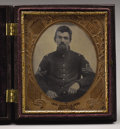 Military & Patriotic:Civil War, Cased 1/6th Plate Tintype of a Federal First Sergeant. Seven general service eagle buttons are seen on the nine-button shell...