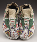 American Indian Art:Beadwork and Quillwork, A PAIR OF SIOUX BEADED HIDE CEREMONIAL MOCCASINS. c. 1885... (Total: 2 Items)