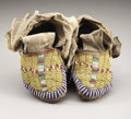 American Indian Art:Beadwork and Quillwork, A PAIR OF SIOUX CHILD'S BEADED HIDE MOCCASINS. c. 1890... (Total: 2Items)