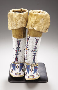 A MATCHED PAIR OF CHEYENNE WOMAN'S BEADED HIDE MOCCASINS AND LEGGINGS c. 1880