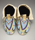 American Indian Art:Beadwork and Quillwork, A PAIR OF SIOUX BEADED HIDE MOCCASINS. c. 1890. ... (Total: 2Items)