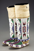 American Indian Art:Beadwork and Quillwork, A MATCHED PAIR OF SIOUX WOMAN'S BEADED HIDE MOCCASINS AND LEGGINGS.c. 1890... (Total: 2 Items)