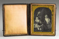Photography:Daguerreotypes, African-American Nursemaid (Slave) with Two White Children, CasedDaguerreotype, ca. 1850s. . ...