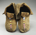 American Indian Art:Beadwork and Quillwork, A PAIR OF CROW BEADED HIDE MOCCASINS. c. 1890... (Total: 2 Items)