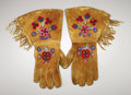 American Indian Art:Beadwork and Quillwork, A PAIR OF ATHABASKAN BEADED HIDE GAUNTLETS. c. 1930. ... (Total: 2Items)