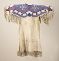 American Indian Art:Beadwork and Quillwork, A SIOUX BEADED HIDE GIRL'S DRESS. c. 1900...