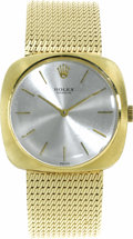 Timepieces:Wristwatch, Rolex, Men's Gold Integral Bracelet Wristwatch, circa 1960. Case:32 mm, 14k yellow gold. Dial: silvered with applied gold...