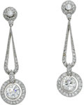 Estate Jewelry:Earrings, Diamond, Platinum Earrings. Each dangling earring features full andsingle-cut diamonds weighing a total of approximately ...